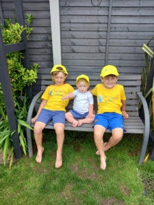 Brin and his brothers sitting on a bench